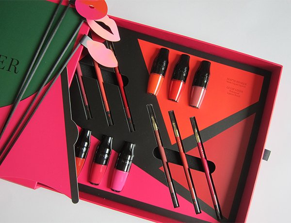 Opening the Lancome Matte Shaker Press Kit, open to photobooth props (Image by Hey Pretty Beauty Blog)