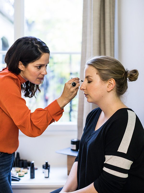 Make-Up Artist and Skincare expert Lina Hanson at work on Sandra of Hey Pretty